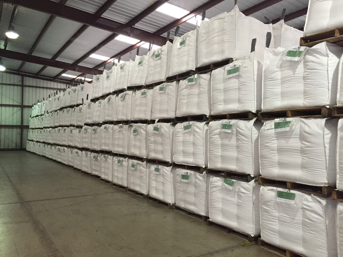 Bulk bags in warehouse with document pouches | BulkSak
